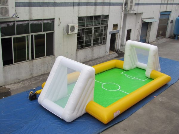 SMALL,YELLOW BOUNCY FOOTBALL FIELD
